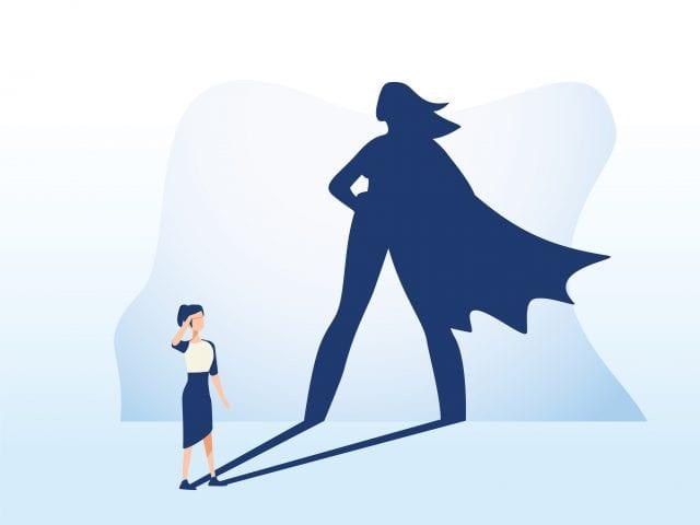 illustration d'un femme dont l'ombre la représente avec uen cape d'héroîne